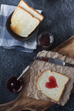 Homemade toast with strawberry jam in shape of heart , valentines day breakfast Royalty Free Stock Photos