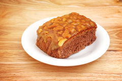 Homemade toffee cake and white plate Stock Image