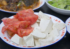 Homemade Tofu and Fresh Tomatoes. A serving of homemade tofu and fresh garden-picked tomatoes Stock Photos