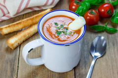 Homemade tomato basil soup in the mug, served with mozzarella cheese stick Royalty Free Stock Photos