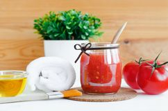 Homemade tomato face mask in a glass jar. Diy cosmetics. Stock Photo