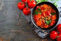Homemade tomato, lentil soup, above, corner border on slate Royalty Free Stock Images
