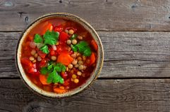Homemade tomato, lentil soup, overhead, close up on wood Stock Photography