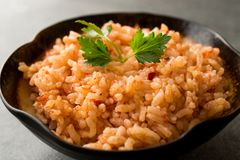 Homemade Tomato Rice with Parsley in Ceramic Bowl / Pilav / Pilaf. royalty free stock images
