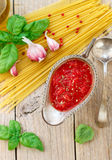 Homemade tomato sauce for pasta and meat from fresh tomatoes  with garlic, Basil and spices Royalty Free Stock Images
