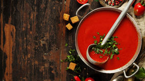 Homemade Tomato soup on wooden table Royalty Free Stock Image