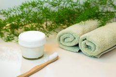 Homemade toothpaste and bamboo toothbrush, towels and greens on Royalty Free Stock Photo