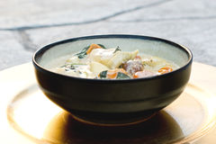 Homemade Tortellini Soup with Vegetables in a Bowl. On a Golden Plate Royalty Free Stock Images