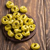 Homemade Tortellini with spinach, cheese and ricotta stock photography