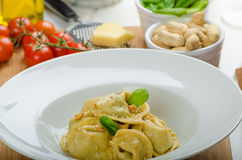 Homemade tortellini stuffed with spinach and garlic Stock Photo