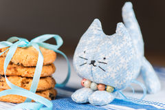 Homemade toy cat and cookie shallow dof Stock Images