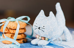 Homemade toy cat and cookie on tablecloth Royalty Free Stock Images