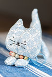 Homemade toy cat front on cloth Stock Images
