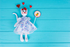 Homemade toy in the form of a cat with gummy hearts around holdi Royalty Free Stock Photo