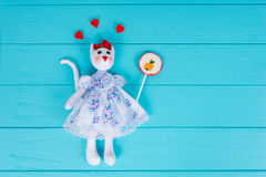 Homemade toy in the form of a cat with gummy hearts around holdi Royalty Free Stock Photography