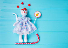 Homemade toy in the form of a cat with gummy hearts around on th Royalty Free Stock Photography