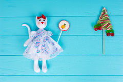 Homemade toy in the form of a cat holding candy near lollipop as Stock Photography