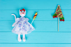 Homemade toy in the form of a cat holding colorful candy near lo Stock Photos