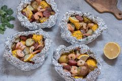 Shrimp Boil with Sausage Potato and Corn foil pack. Homemade Traditional Cajun Shrimp Boil with Sausage Potato and Corn foil pack Stock Image