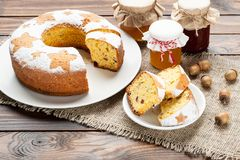 Homemade traditional fruit cake slices on white plate decorated Stock Photos
