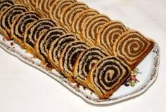 Homemade traditional hungarian christmas cake. Some pieces of traditional hungarian cake poppy rolls beigli on a porcelain plate stock photo