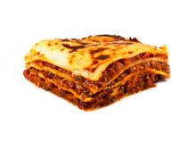 Homemade traditional lasagna and fries. An isolated traditional lasagna made with minced beef bolognese sauce and three layers of pasta, lasagne in English Royalty Free Stock Image