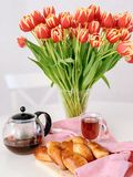 Homemade traditional Russian food, Pirozhki. And tulips on the table stock photo