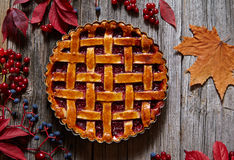 Homemade traditional sweet raspberry autumn pie on vintage wooden table background. Rustic style and natural light. Stock Photo