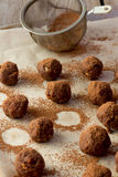 Homemade truffle balls on wooden table Royalty Free Stock Photos