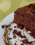 Homemade truffle-cranberry cake chocolate cream cut into pieces on table. Closeup Stock Image