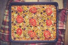 Homemade tuna pizza ready to bake. Royalty Free Stock Images