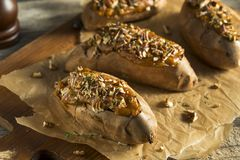 Homemade Twice Baked Sweet Potatoes. With Butter Pecans and Herbs Royalty Free Stock Image