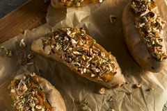 Homemade Twice Baked Sweet Potatoes. With Butter Pecans and Herbs Royalty Free Stock Photography