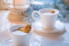 Homemade two gingerbread man in hot chocolate for Christmas Royalty Free Stock Image