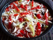 Homemade uncooked fresh italian pizza. stock photo