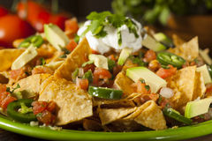 Homemade Unhealthy Nachos with Cheese and Vegetables Royalty Free Stock Photography