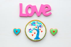 Homemade Valentines day cookies and and Love word on white woode Royalty Free Stock Images