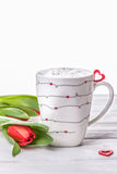 Homemade vanilla coffee latte with love, red heart and spring tulips on white wooden background Stock Photography