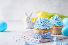 Homemade vanilla cupcakes decorated with sprinkles and ribbon royalty free stock photo