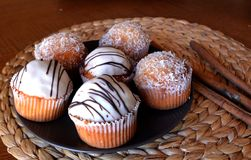 Homemade Vanilla Muffins With Chocolate And Grated Coconut. Royalty Free Stock Photography