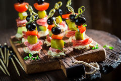 Homemade various finger food with fresh ingredients for snack. On wooden table Stock Images