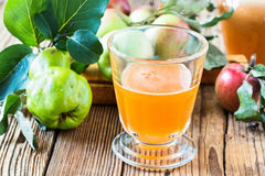 Homemade vegan apple juice with quince Royalty Free Stock Photography