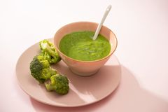 Homemade vegetable baby food. Broccoli puree for baby stock image