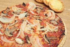 Homemade vegetable pizza. Vegetable pizza on a wooden background Royalty Free Stock Photos