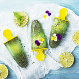 Homemade vegetarian ice cream popsicle fruit citrus peppermint juice with chia seeds is decorated with edible flowers of. Homemade vegetarian ice creampopsicle royalty free stock photo