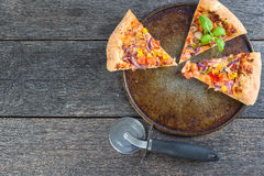 Homemade vegetarian pizza from above on wooden table Stock Images