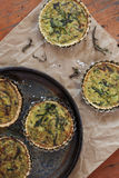 Homemade vegetarian salty tartellettes with leeks rocket Stock Images