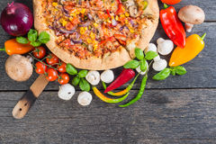 Homemade vegeterian pizza from above on wooden table Royalty Free Stock Photo