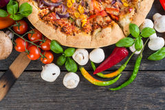 Homemade vegeterian pizza from above on wooden table Stock Image