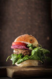 homemade veggie burger in a bun sesame seeds of beer. Stock Image